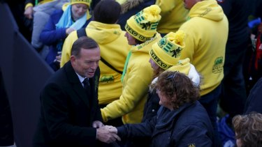 Prime Minister Tony Abbott shakes hands with Australians during the dawn ceremony at Anzac Cove on Saturday.