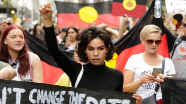 A woman taking part in the Invasion Day Melbourne rally.