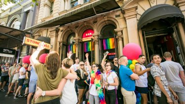"""Supporters of same-sex marriage celebrate the """"yes"""" verdict at the iconic Stonewall Hotel on Sydney's Oxford Street."""