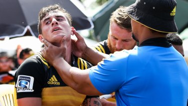 Close to the action: Hurricanes scrum-half TJ Perenara gets a pitchside check-up at the weekend.