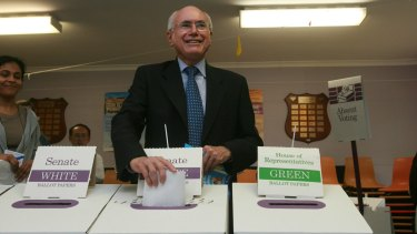 John Howard continued as prime minister in a caretaker capacity after losing his seat.