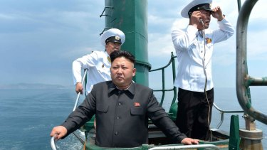 Nuclear ambitions ... This undated picture released by North Korea's official new agency in 2014 claims to show leader Kim Jong-Un inspecting a submarine.