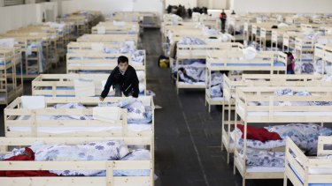 A new temporary shelter for migrants and refugees at a fair grounds hall in Berlin.