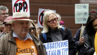 Protesters rally against the TPP.