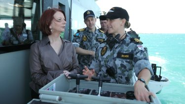 Julia Gillard visits navy personnel on HMAS Broome, off Darwin, in July 2010.