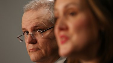 Scott Morrison and Kelly O'Dwyer have received praise from George Christensen, a previous critic of their super policy.