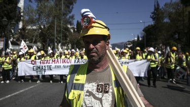Miners march to the parliament during a rally in Athens on Thursday.