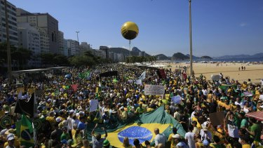 Demonstrators gather on Copacabana beach during a protest in Rio de Janeiro, Brazil, on Sunday. Similar crowds are estimated at 1 to 2 million during New Year's Eve festivities.