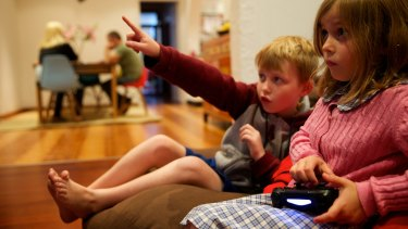 Engaged: Liam Hunter, 9 and Eve Hunter, 6, play Minecraft at their Leichhardt home.