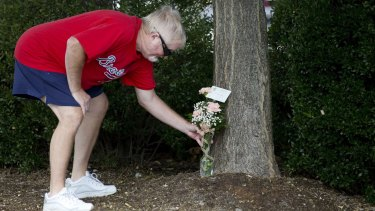 Rodney Booth delivers flowers to WDBJ's Digital Broadcast Centre, in Roanoke, Virginia, after hearing news of the fatal shooting of two of the station's journalists earlier in the day.