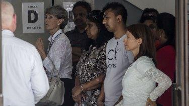 Myuran Sukumaran's mother Raji Sukumaran, centre, and his brother Chinthu Sukumaran, second from right, at Wijaya Pura port to visit her son at Nusakambangan prison on Monday.