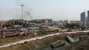 Damaged containers in a waterway near the site of the Tianjin blast.
