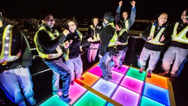 On top of the Bridge, revellers dance on the opening night of Vivid.