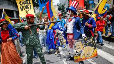 "Government supporters perform a parody involving a Venezuelan militia up against Uncle Sam, a personification of the US government, during an anti-imperialist march to denounce Trump's talk of a ""military option"" in August."