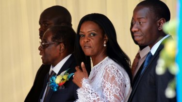 Zimbabwean First Lady Grace Mugabe, centre, and President Robert Mugabe at a ceremony to rename Harare's airport as Robert Gabriel Mugabe International Airport last week.