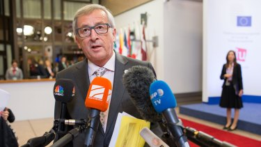 Jean-Claude Juncker, president of the European Commission, speaks with journalists following all-night Greece bailout talks in Brussels, Belgium.