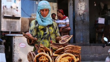 Marriam travels from Sabir Mountain to the city centre of Taiz to sell bread and earn an income. Her grandchildren are reliant on her income after their parents died.