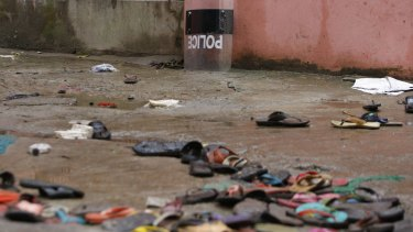 Slippers lie strewn around at the site of a stampede in the town of Mymensingh, 115 kilometres north of Dhaka, Bangladesh, where dozens died on Friday.