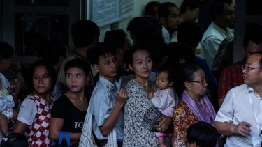 Voters line up at a polling station in the Golden Valley township in Yangon on November 8.