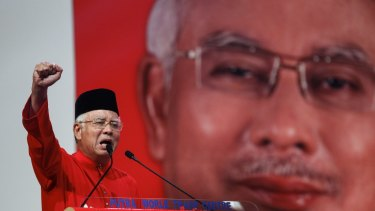 Malaysian Prime Minister Najib Razak addresses delegates during his speech at the United Malays National Organisation's (UMNO) anniversary celebration in Kuala Lumpur in May