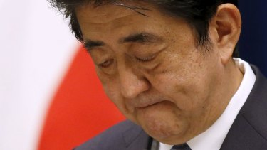 Mr Abe delivers his contentious statement marking the 70th anniversary of the end of World War II.
