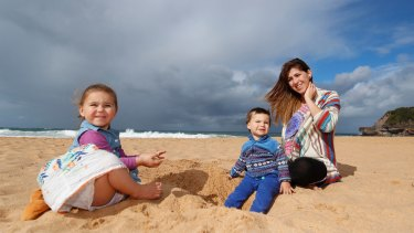 Marian Russell with her two children, Allegra, 2, and Bodie, 1, at Warriewood beach.