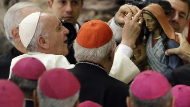 Pope Francis gives an audience with Roma, Sinti and others itinerant group members, at the Vatican on Monday.