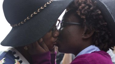 Tori Sisson and Shante Wolfe, kiss after saying their marriage vows in Montgomery, Alabama.