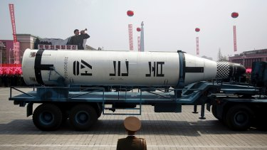 A submarine missile is paraded across Kim Il-sung Square during a military parade in Pyongyang, North Korea on Saturday.