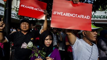 """People hold placards and banners displaying the words """"we are not afraid"""" during a rally after the Jakarta terrorist attack  in January."""