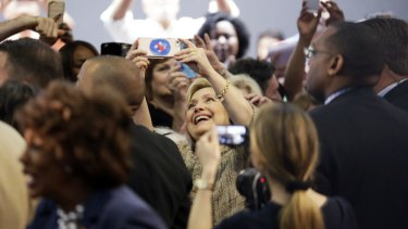 Hillary Clinton takes a selfie with supporters in Los Angeles.