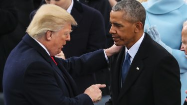 America First: Donald Trump speaks to Barack Obama after his inaugural speech, in which he condemned his predecessors.