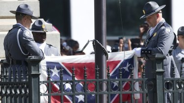 Symbol of hate ... The Confederate battle flag is removed from the Capitol grounds in Columbia, South Carolina.