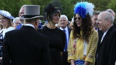Prince Philip, left, meets British singer Eliza Doolittle (second right).
