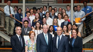 NSW ministers Adrian Piccoli and Leslie Williams, at right, with school students who topped an HSC subject.