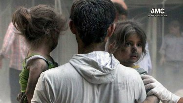 This image from a rebel media service shows Syrian children being rescued from a building hit by a regime air strike in the Shaar district of Aleppo in July.
