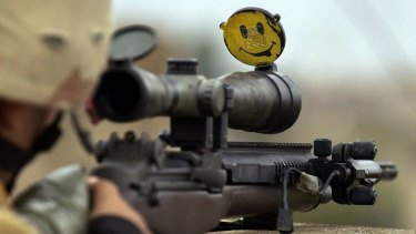 A happy face smiles back from the scope of a US Army sniper's rifle in Iraq. The US is the world's top weapons supplier.