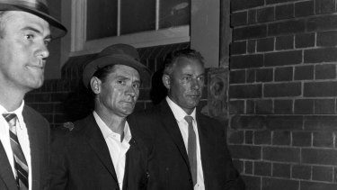 Melbourne prison escapee Ronald Ryan is taken to police headquarters in Sydney after his recapture, 5 January 1966.