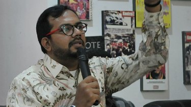 Haris Azhar at Kontras during a press conference.