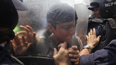 Protesters clash with police outside the prime minister's office on Sunday.