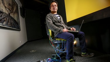 "Dr Stephen Jia Wang testing a prototype of his smart chair designed to ""get to know you and your sitting behaviour""."