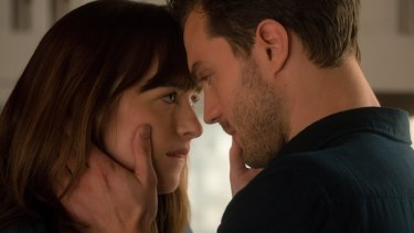 Dakota Johnson and Jamie Dornan in <i>Fifty Shades Darker</i>.