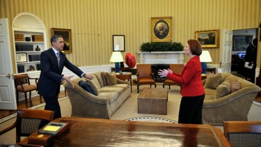 Then-Prime Minister Julia Gillard gave President Obama his first AFL ball during her visit to Washington in March 2011.
