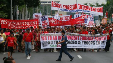 Protesters reject US troops in the Philippines in Manila on Wednesday. But how will the wider population of the Philippines greet the president's new direction?