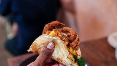 Roti taco of soft shell crab, mango salsa, fried curry leaf.