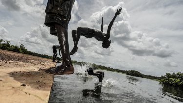 Children play in the flooded community of Palumpa, Northern Territory.