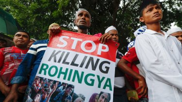 A Rohingya holds a banner during a protest after Friday prayers outside the Myanmar embassy in Kuala Lumpur, Malaysia, in November.