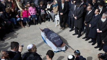 Family and friends of Israeli Dafna Meir attend her funeral at a cemetery in Jerusalem on Monday. A Palestinian attacker stabbed and wounded a pregnant Israeli woman in the West Bank before being shot, Israeli officials said.
