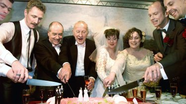 From left: Peter Lemke, Frank Wittebrood, Ton Jansen, Louis Rogmans, Helene Faasen, Anne-Marie Thus, Dolf Pasker and Geert Kasteel cut the cake after their wedding ceremony in the town hall of Amsterdam on April 1, 2001. The two lesbian brides and six gay grooms became the world's first homosexuals to wed legally, minutes after a Dutch law allowing same-sex matrimony came into effect.