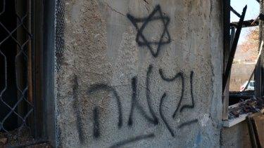 "Hebrew graffiti - ""Revenge"" - sprayed on the wall of the Dawabshe family home."